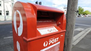 Aust Post loses $87m on letters in half year results